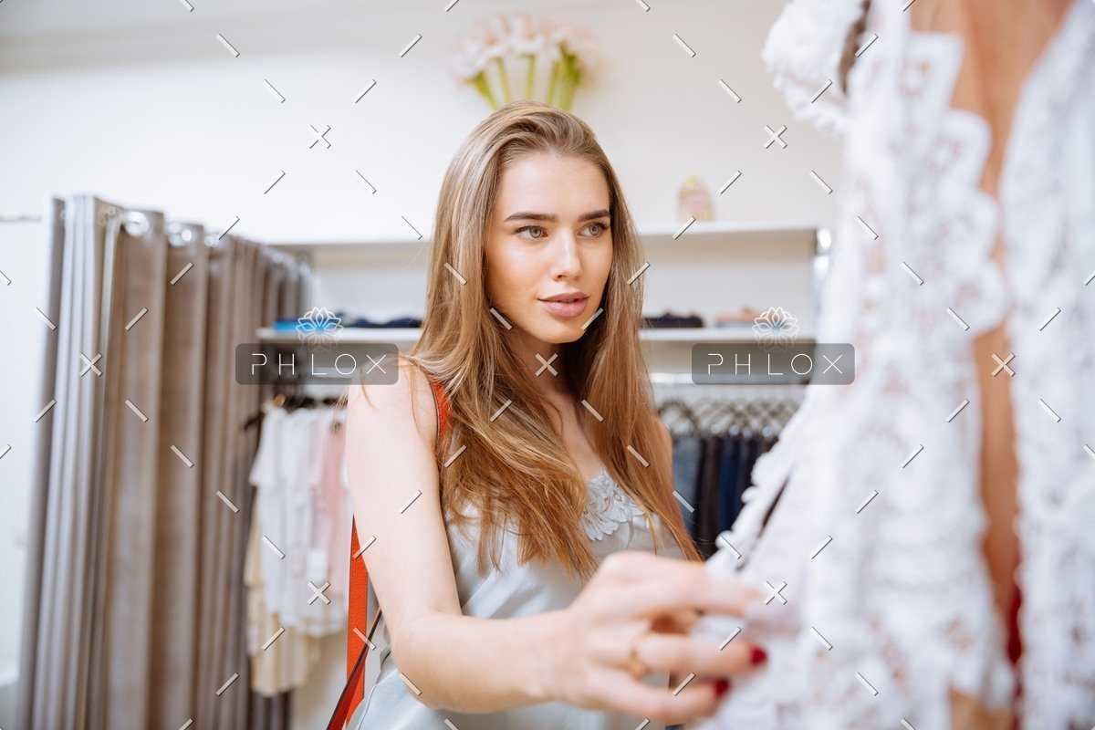 demo-attachment-141-woman-doing-shopping-and-choosing-clothes-in-PDEP6XU